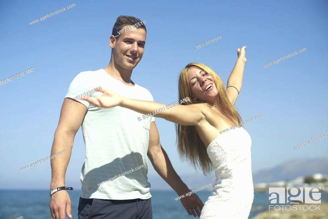 Stock Photo: Couple in summer holiday, dancing. Crete, Greece.