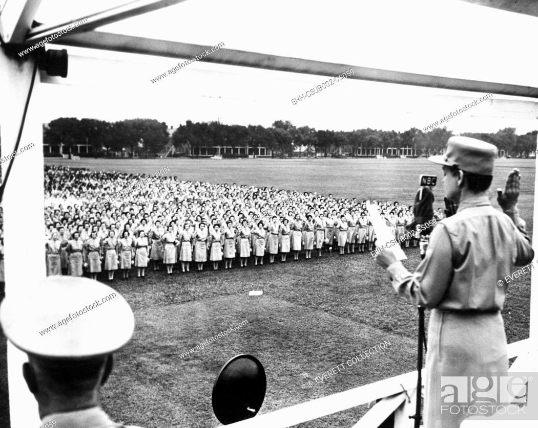 Stock Photo: Col. Oveta Culp Hobby administering the Army oath to several thousand women. Aug. 5, 1943. They were in newly named, 'Women's Army Corps.