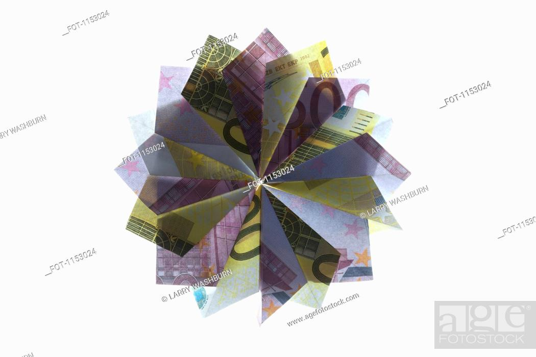 Stock Photo: Five hundred Euro bills and two hundred Euro bills folded into a pinwheel shape.