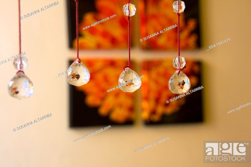 Imagen: Crystal beaded curtain in front of photo.