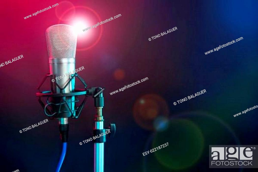 Imagen: Microphone in the night colorful light.