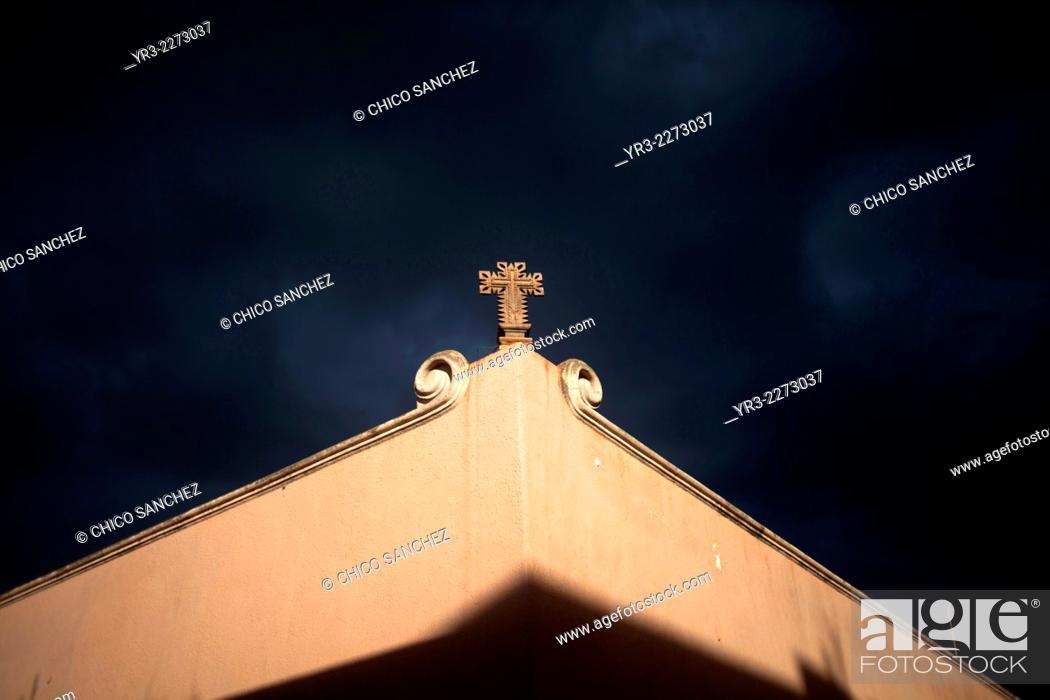 A Cros Decorates A Corner Of A Colonial Building In Queretaro