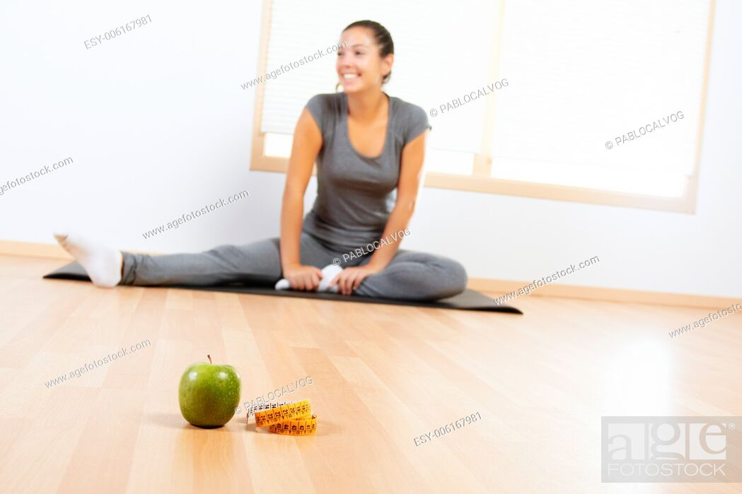 Stock Photo: Elements of a healthy lifestyle with beautiful girl doing sport in the background.