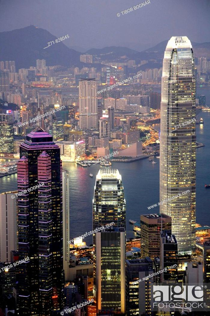 Stock Photo: China, Hong Kong, Victoria Harbour, skyline at night, International Financial Centre.