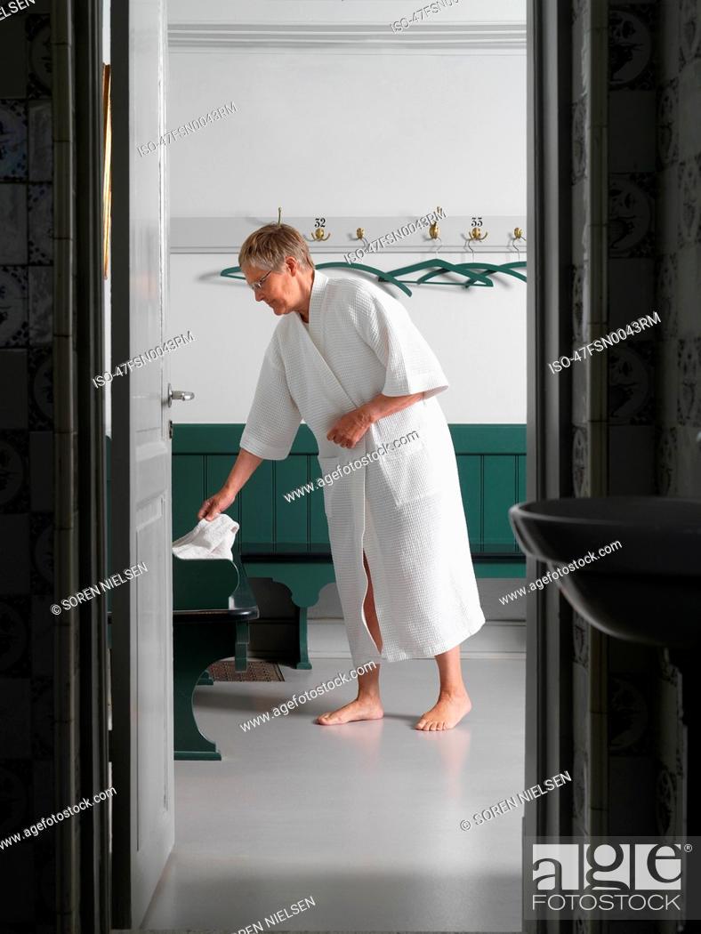 Stock Photo: Older man in bathrobe in locker room.
