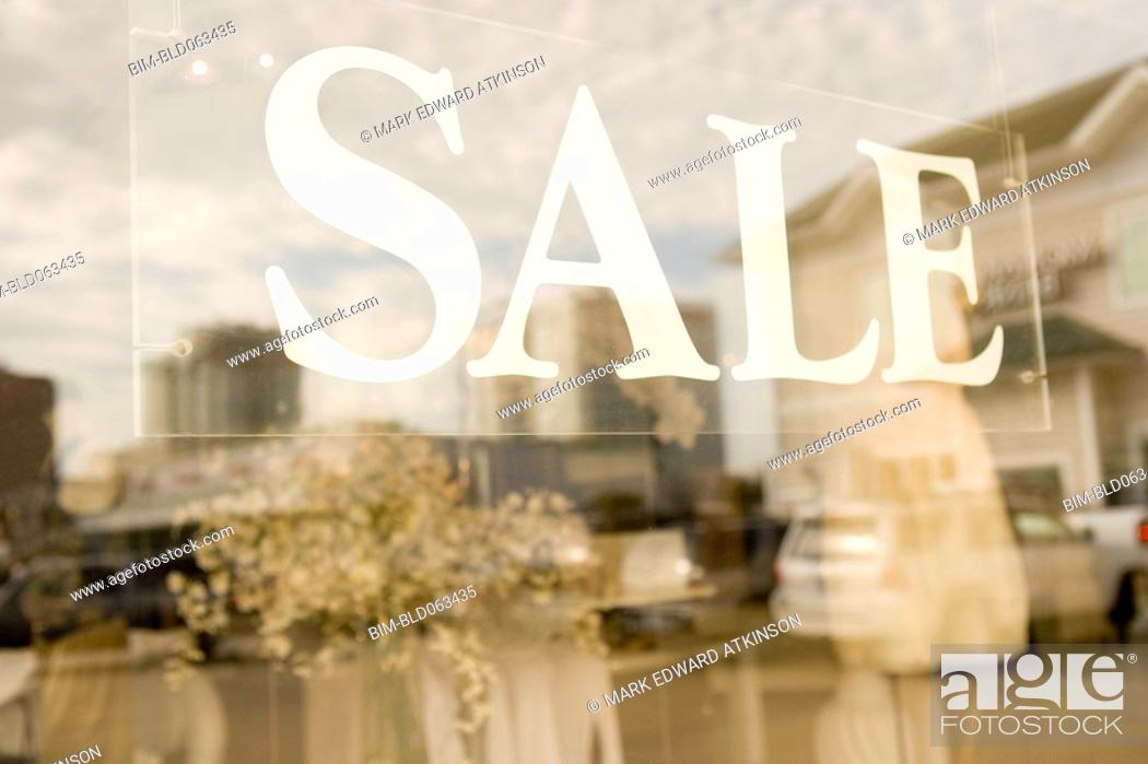 Stock Photo: Sale sign in shop window.