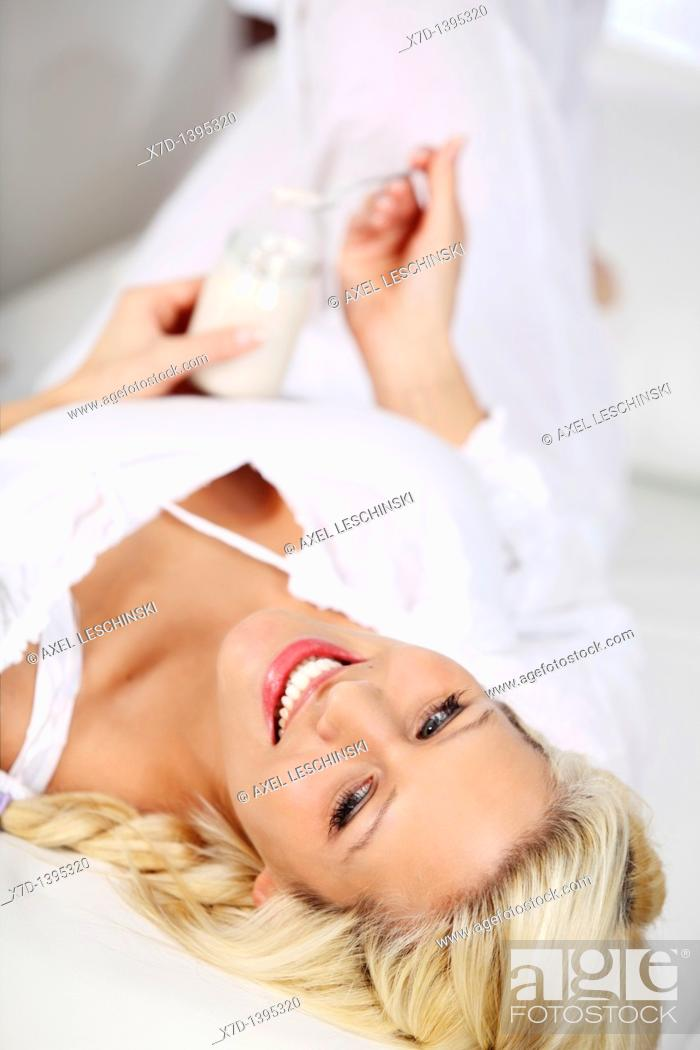 Stock Photo: woman eating yoghurt.