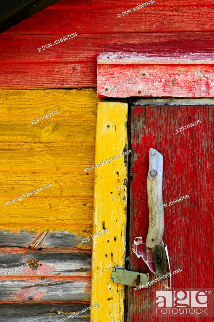 Stock Photo: Peeling paint and weathered wood on an old shed.