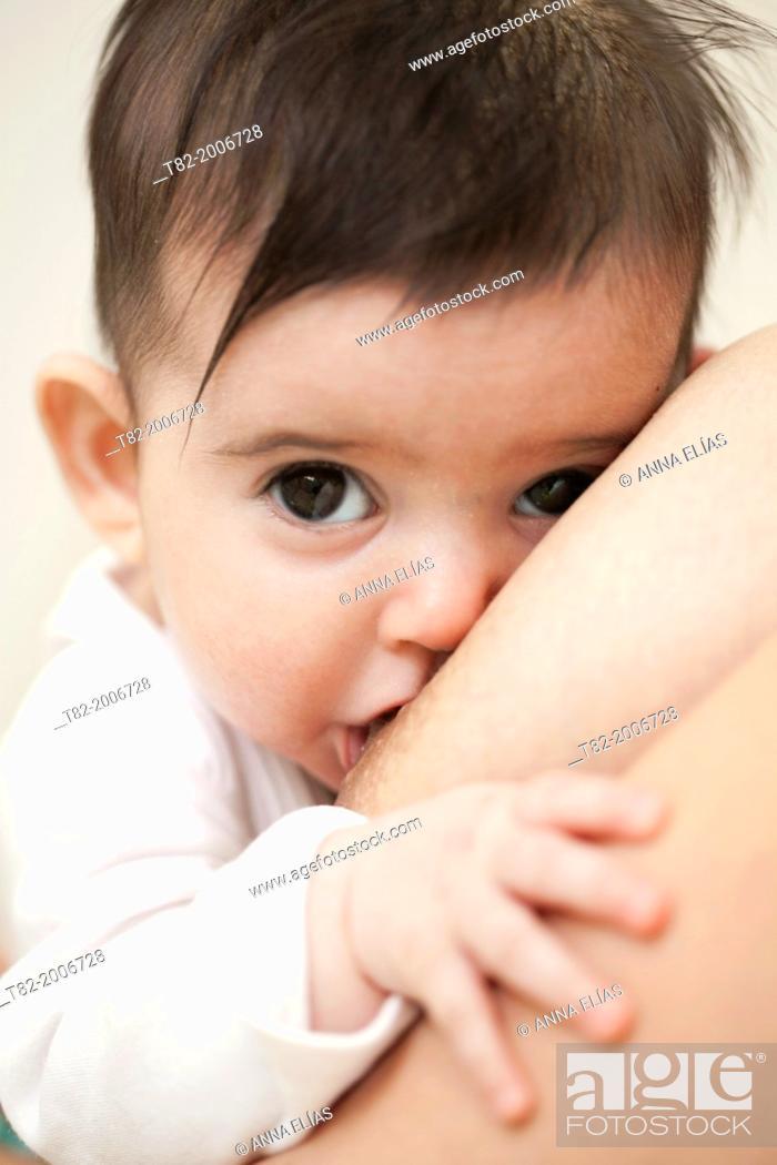 Stock Photo: nursing baby face and looking at camera.