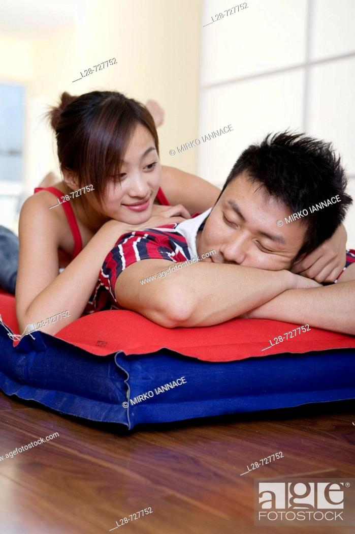 Stock Photo: Young couple sleeping on bed, close-up.