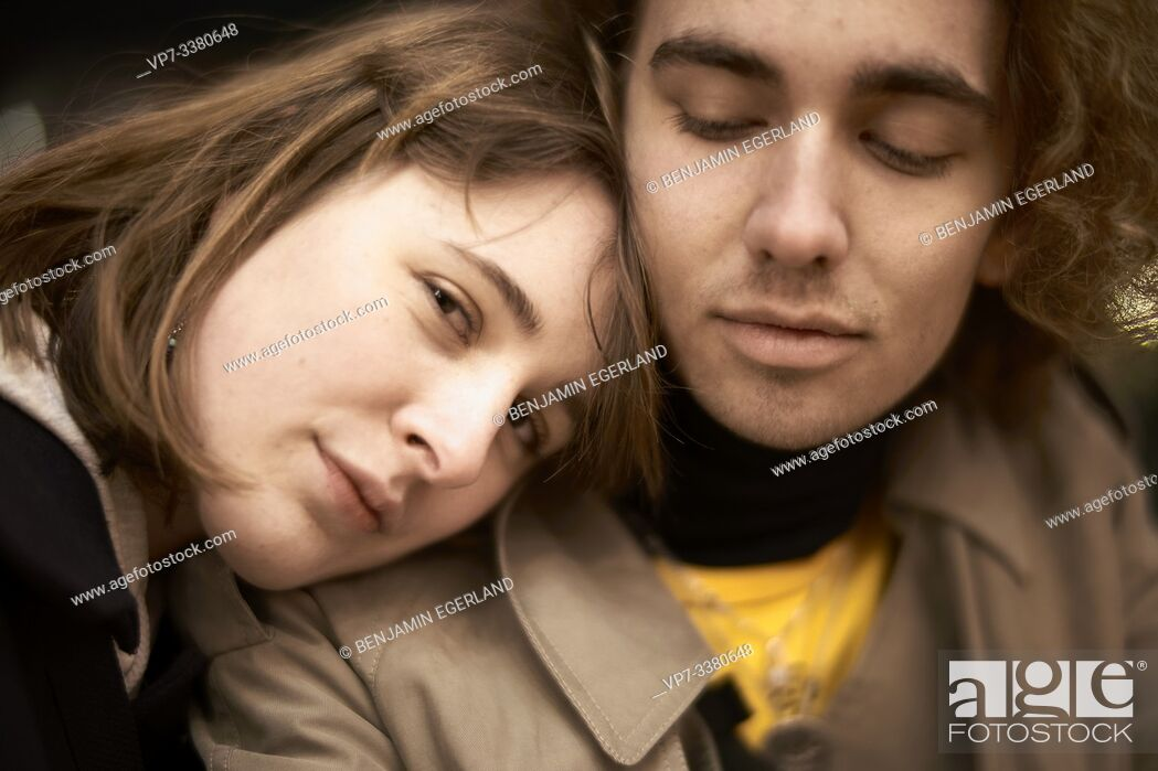 Stock Photo: woman resting on shoulders of man.
