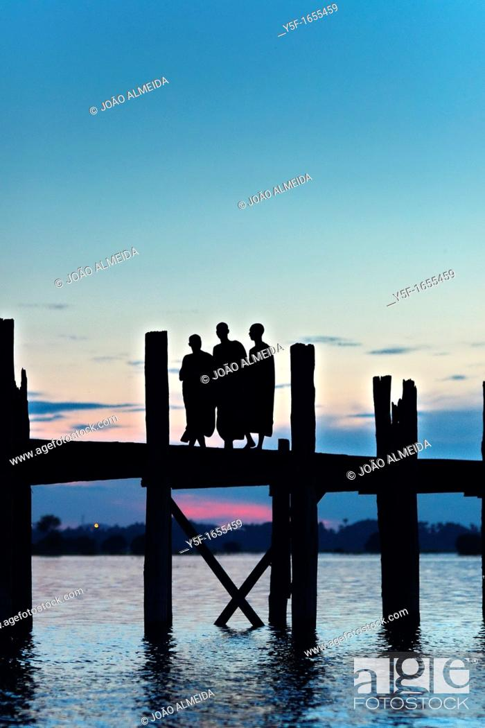 Stock Photo: Monks at U Bein bridge.