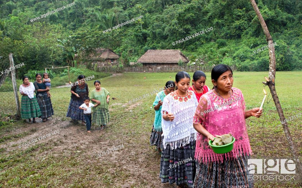 Stock Photo: Chahal, Alta Verapaz, Guatemala, women bring offers for the ceremony to pray for a good harvest.