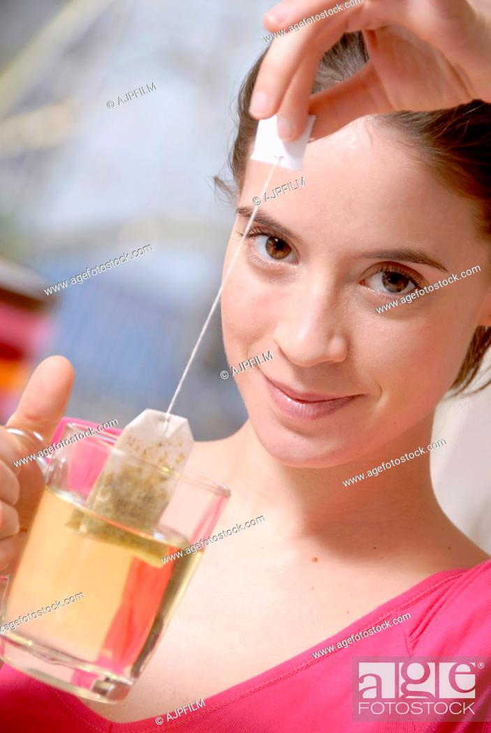 Stock Photo: Woman drinking herbal tea.