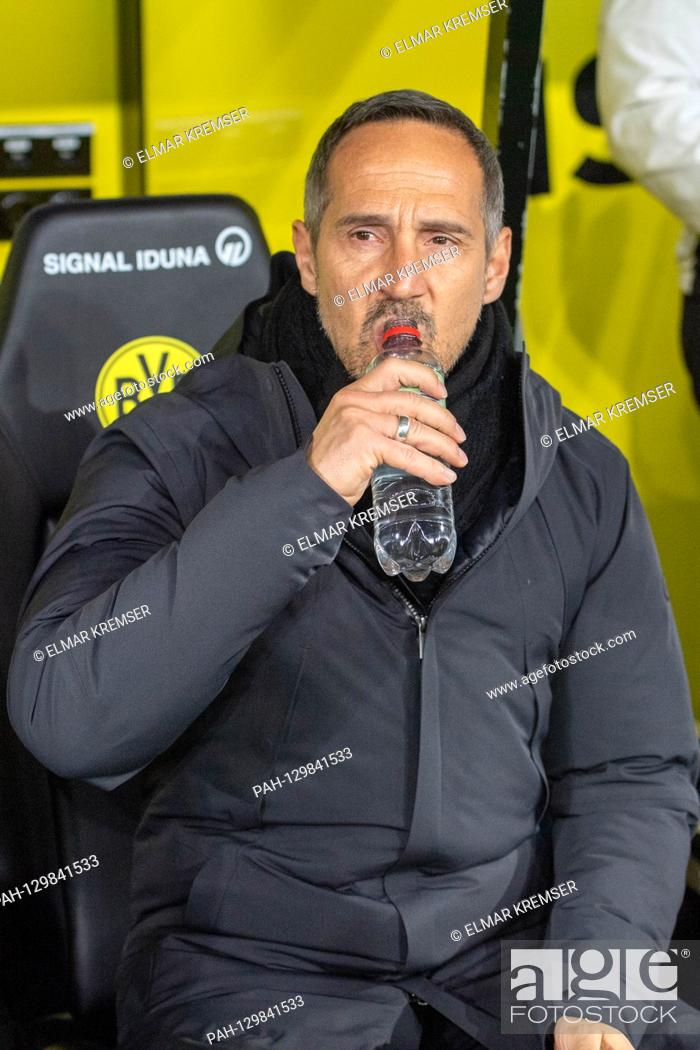 Stock Photo: Adi HUETTER (Hvºtter, coach, F) sits in his seat and drinks from a water bottle, drinking, half figure, half figure, portrait format, football 1.