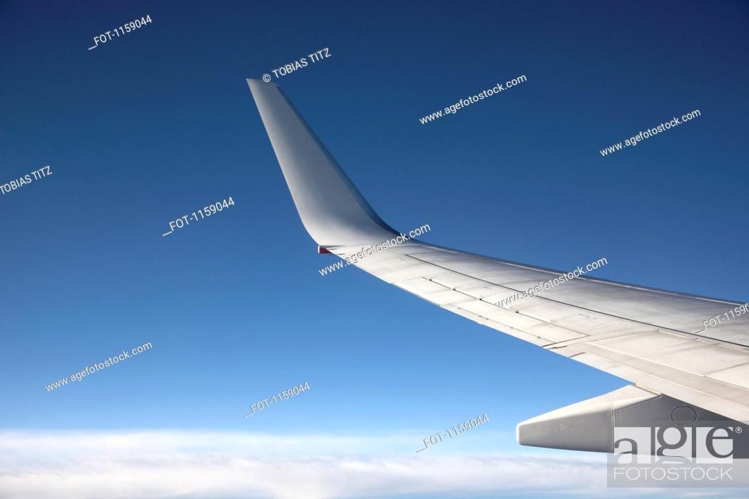 Stock Photo: Jet above the clouds.