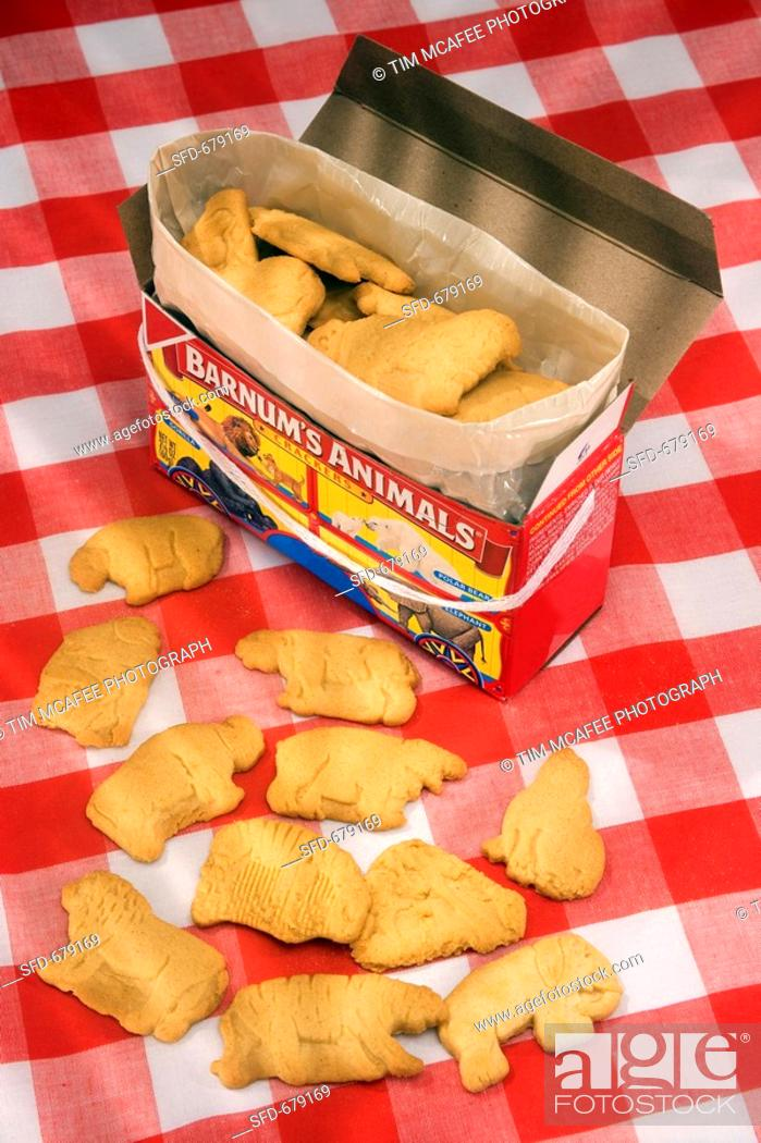 Stock Photo: Animal Crackers In and Out of the Box, On Checked Cloth.