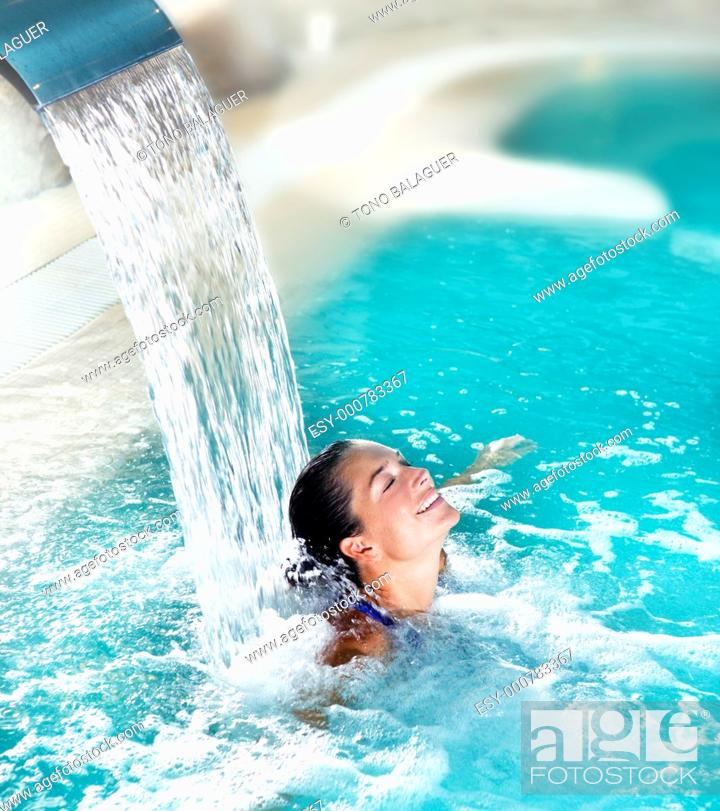 Stock Photo: spa hydrotherapy woman waterfall jet turquoise swimming pool water.