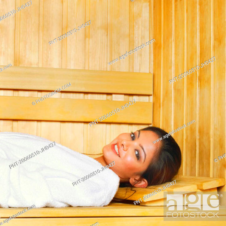 Stock Photo: Portrait of a young woman lying in a sauna.