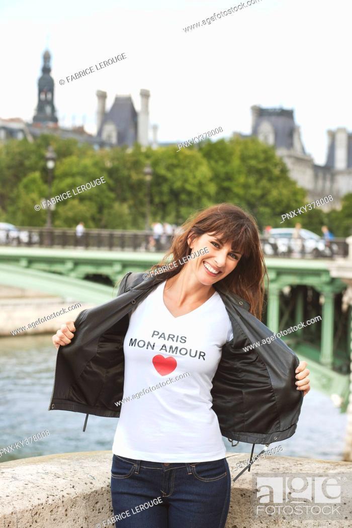 Stock Photo: Woman enjoying at the riverside, Seine River, Paris, Ile-de-France, France.