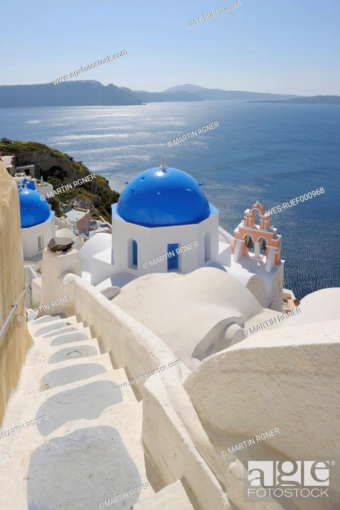 Stock Photo: Greece, Santorini, View of whitewashed church and bell tower at Oia.