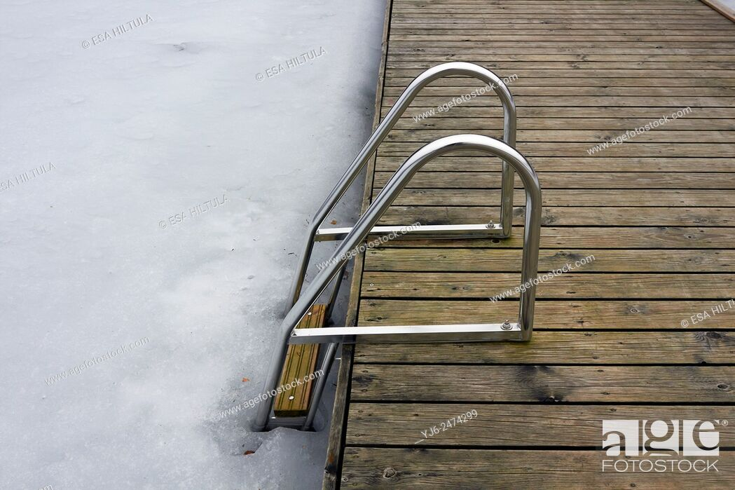 Stock Photo: hand-rails leading to frozen lake, Finland.