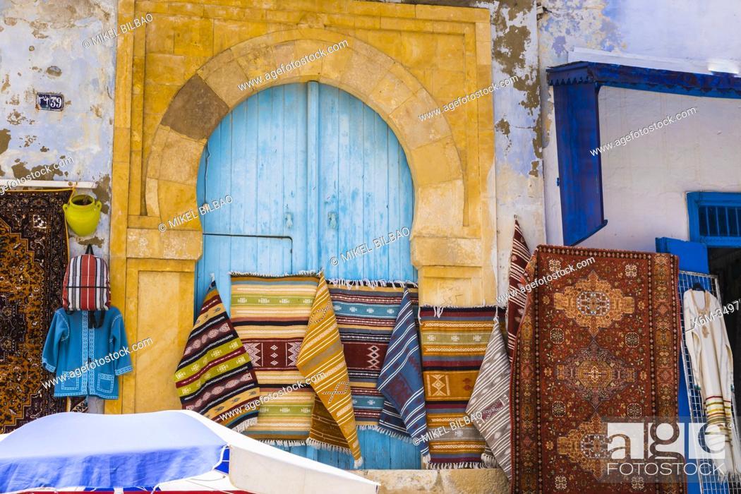 Stock Photo: Carpet shop. Street view. Medina. Kairouan. Tunisia. Africa.