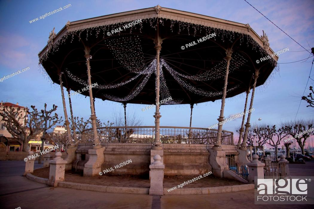 Stock Photo: A classical pavilion decorated with fairy lights.