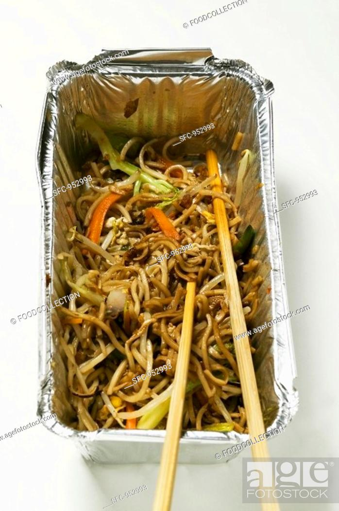 Stock Photo: Remains of fried noodles in aluminium container.