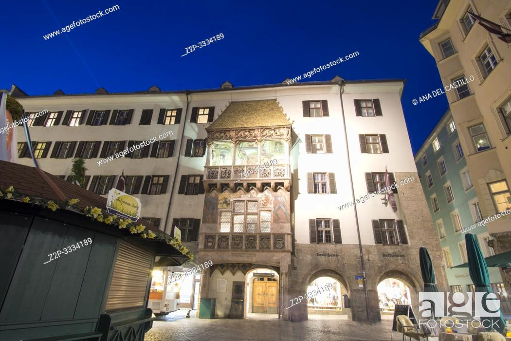 Stock Photo: Innsbruck city center Austria on April 16, 2019: Easter market and golden roof by dusk.