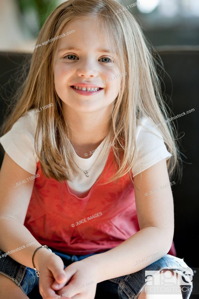 Stock Photo: Portrait of young girl, smiling.