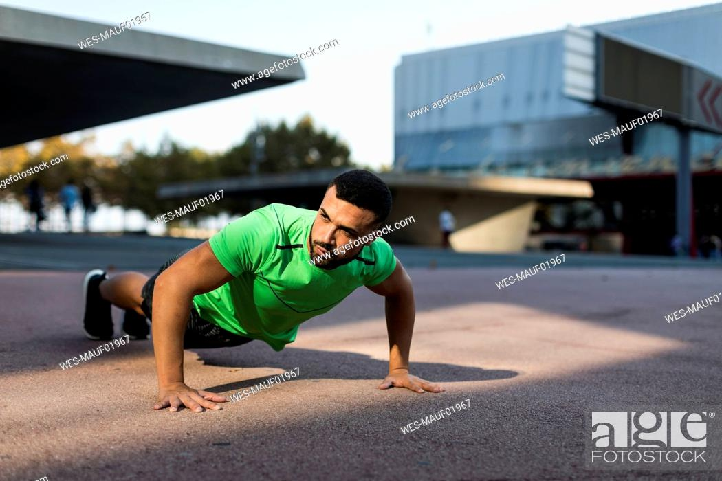 Stock Photo: Sportive man during workout, pushup.