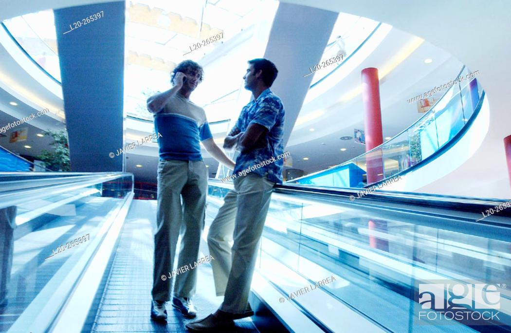 Stock Photo: Men in shopping center.
