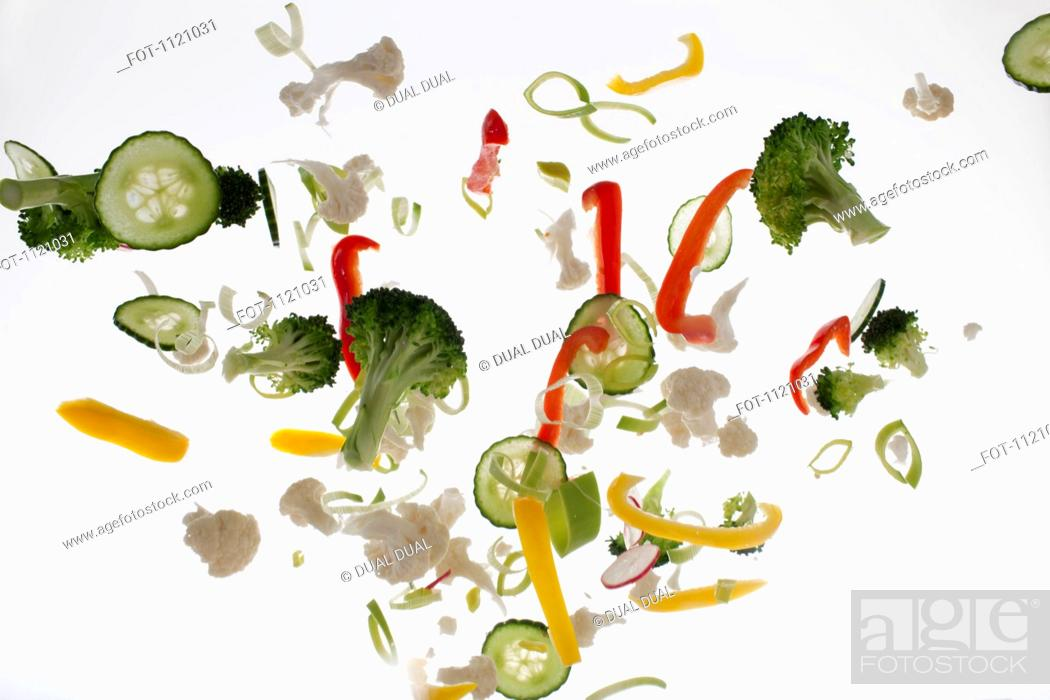 Stock Photo: Vegetables against a white background.