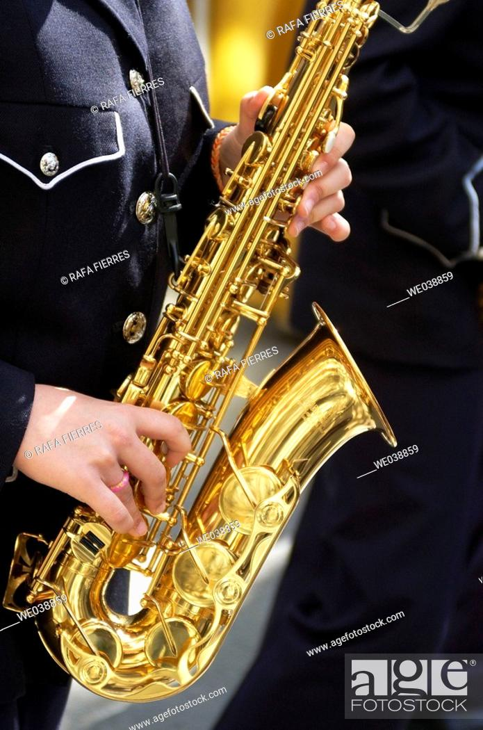 Stock Photo: Young woman playing the saxophone. Holy Week. Albacete, Castilla-La Mancha , Spain.