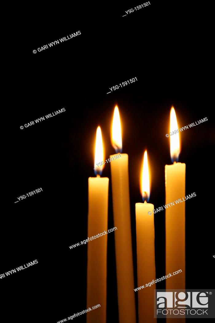 Four Lit Candles In Dark Room In Church Stock Photo Picture And