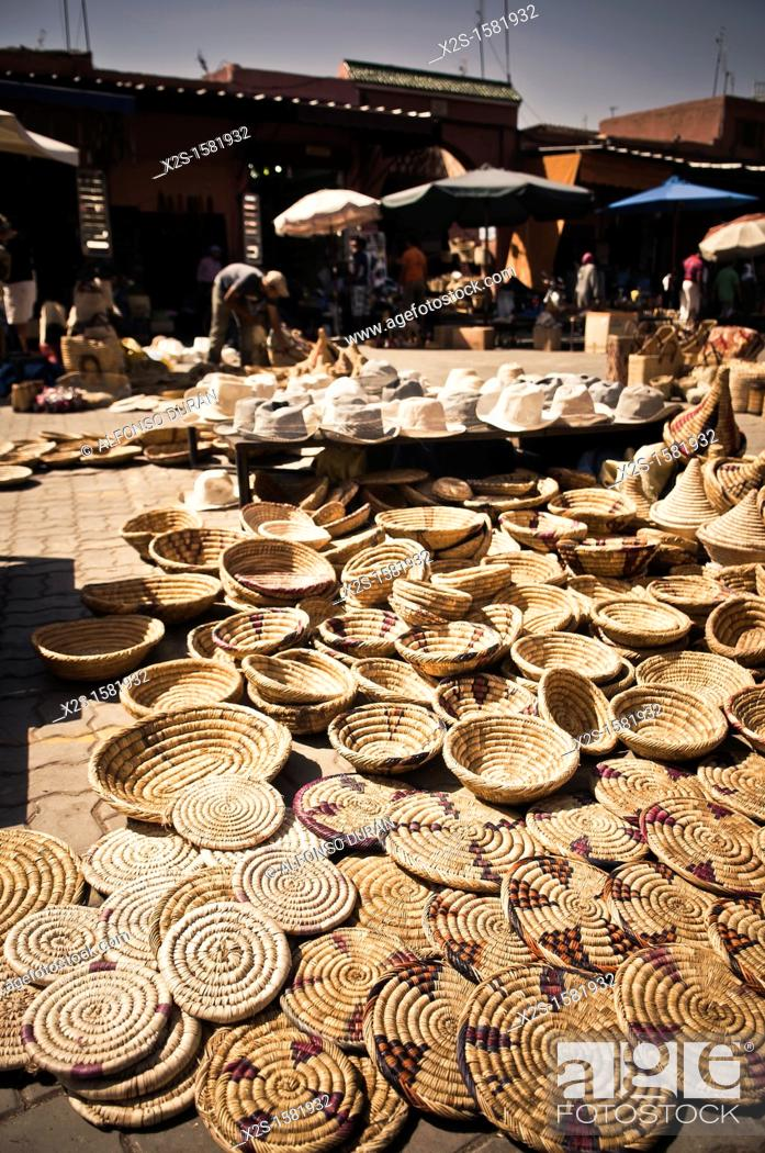 Stock Photo: store wicker baskets and hats in the souk, Marrakech, Morocco.