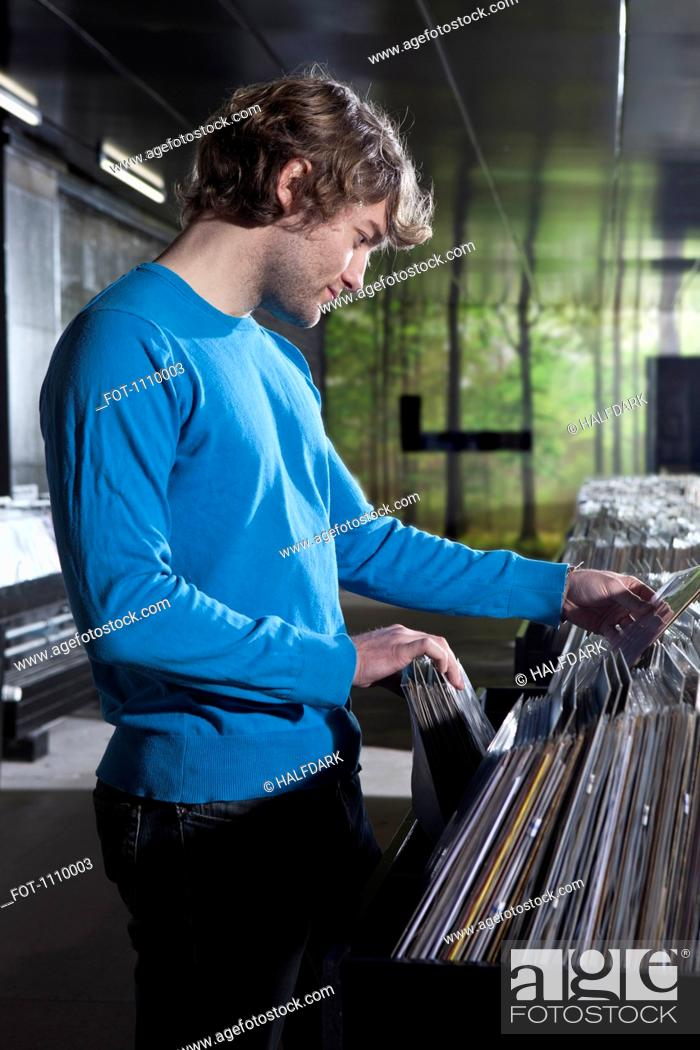 Stock Photo: A young man shopping in a record store.