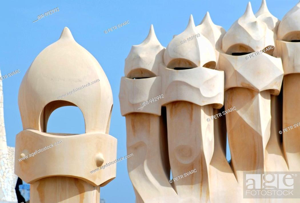 Photo de stock: Warrior-like chimneys on the roof terrace of Casa Milá, La Pedrera, residential building by Catalan architect Antoni Gaudi on the Passeig de Gracia.