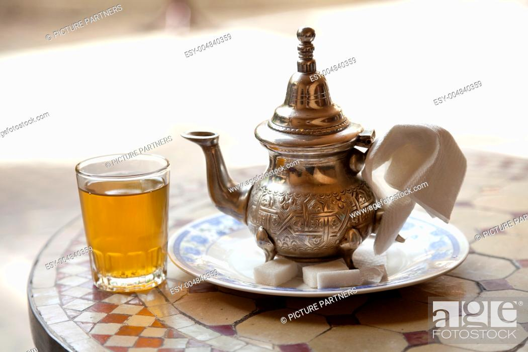 Stock Photo: Drinking traditional tea in Marrakesh Morocco.