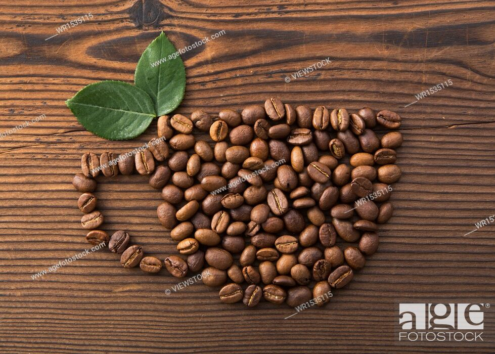 Stock Photo: Ideas into a cup of coffee beans.