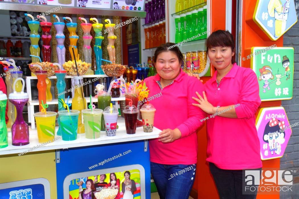 Stock Photo: China, Beijing, Dongcheng District, Nanluoguxiang, hutong, historic, drink, vendor, sale, Asian, woman, coworkers, job, manager, tea,.