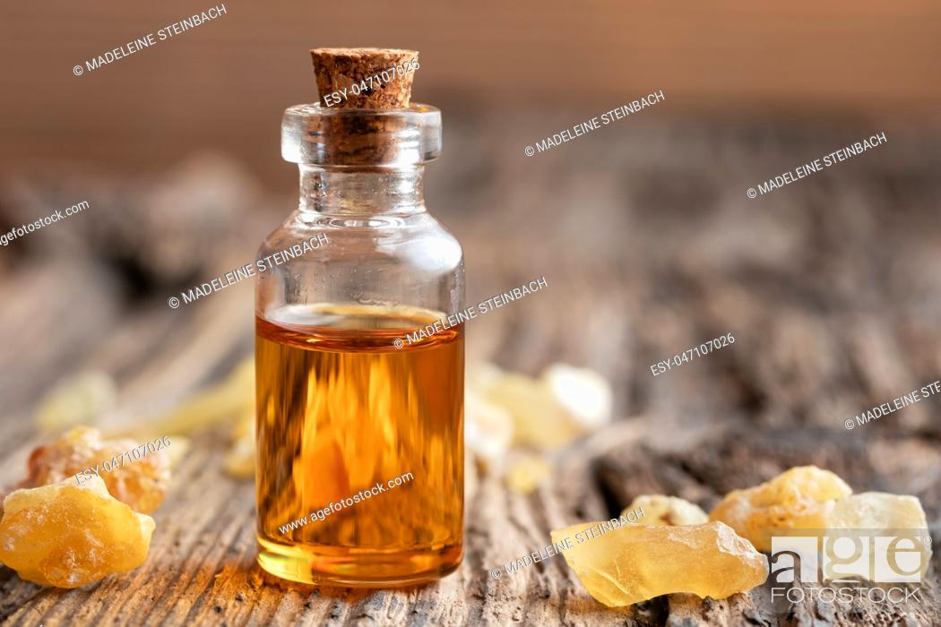 Stock Photo: A bottle of essential oil with frankincense resin.