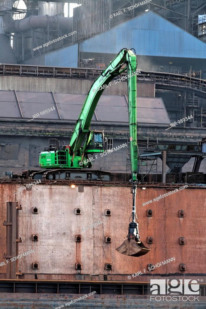 Stock Photo: Modern mechanical digger, unloading in front of industrial setting, Krupp Mannesman smeltery, Rhine harbour, Duisburg, Ruhr area, North Rhine-Westphalia.