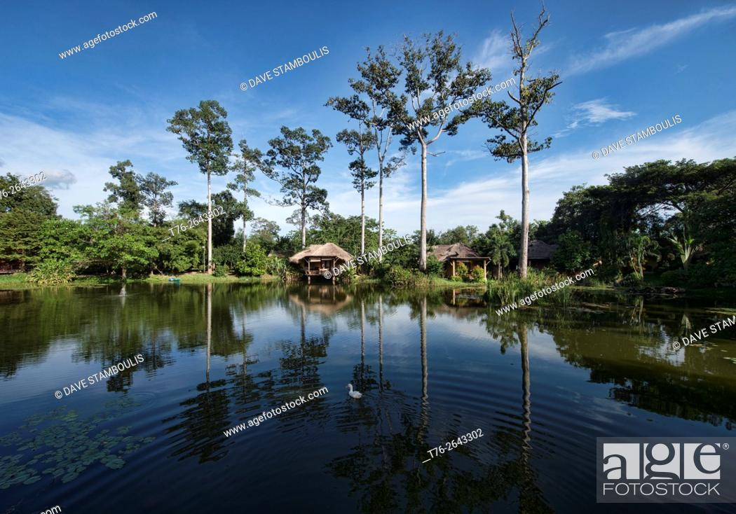 Stock Photo: Traditional Thai houses on a quiet lake, Hua Hin, Thailand.