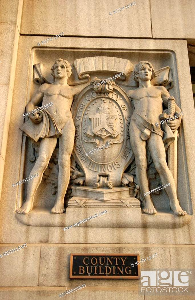 Stock Photo: Chicago, Illinois, Carved stone statue on County Building in Chicago.
