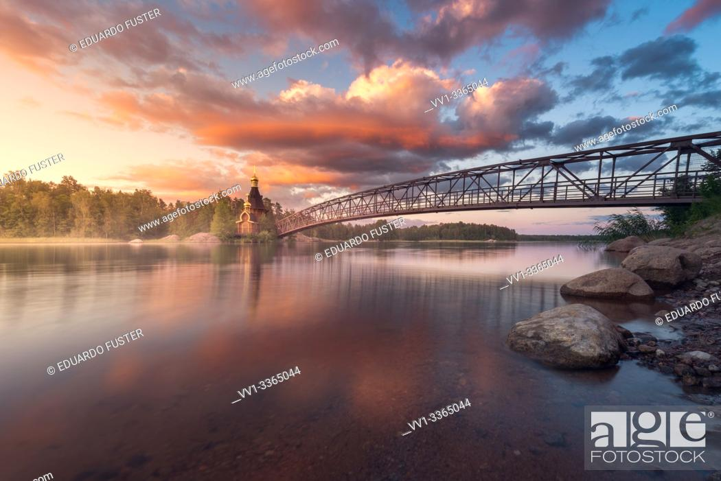 Stock Photo: Church of Apostle Andrew the First-Called on the Vuoksa River during sunset. Leningrad region, Russia.