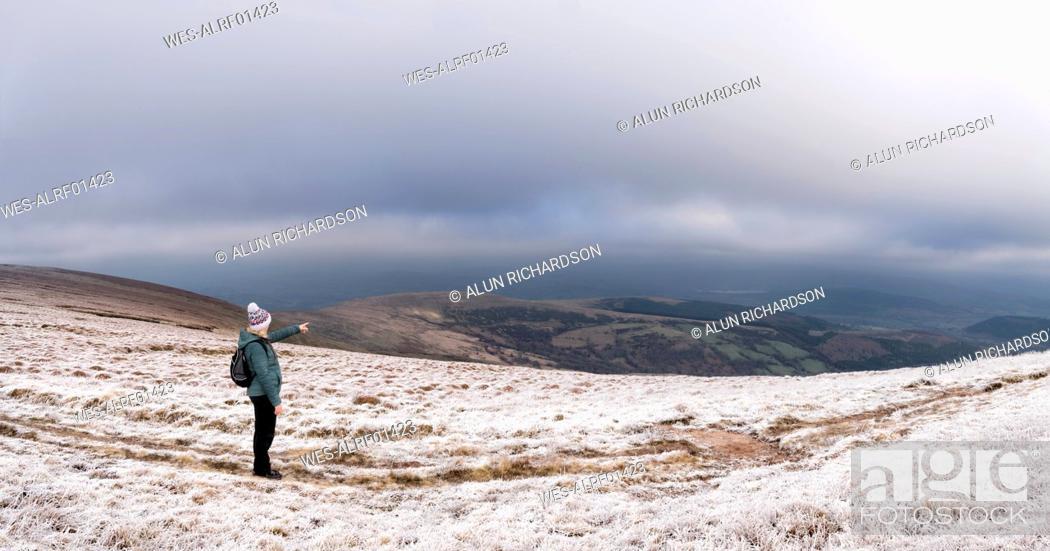 Stock Photo: UK, Wales, Brecon Beacons, Craig y Fan Ddu, woman hiking in winter landscape.
