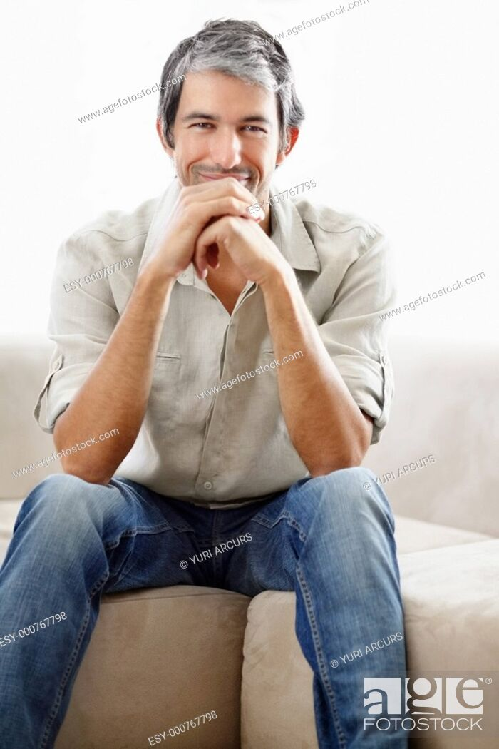 Photo de stock: Confident middle aged man sitting and smiling against white background.