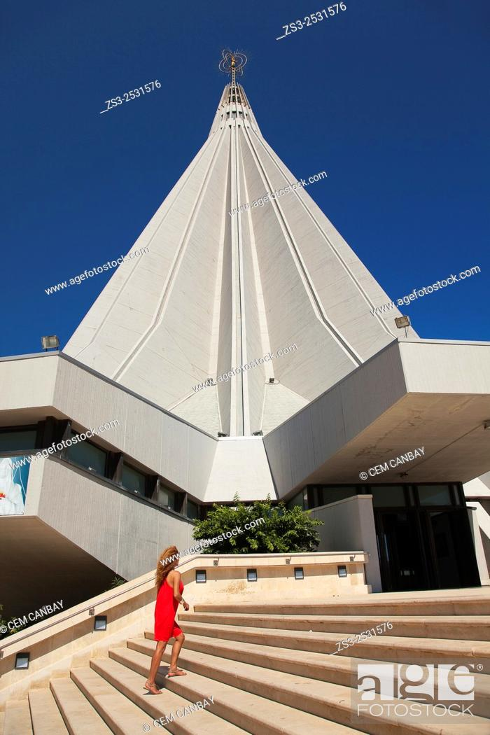Stock Photo: Tourist in front of the Santuario della Madonnina delle Lacrime -the Sanctuary of the Madonna of Tears church in Tyche district, Syracuse, Sicily, Italy, Europe.